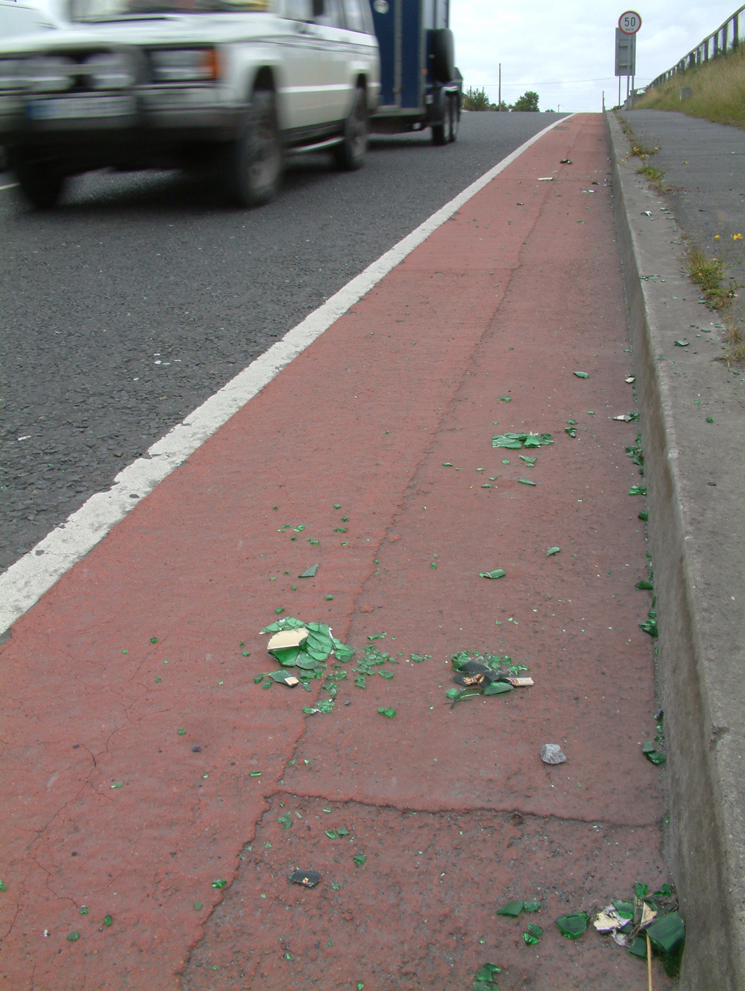Parkmore road - glass in the cycle lane